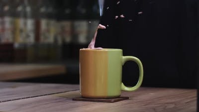 Throwing a Sugar Cube in a Cup of Coffee