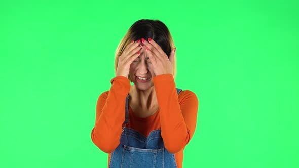 Cover Image for Woman Suffering From Headache From Fatigue. Green Screen