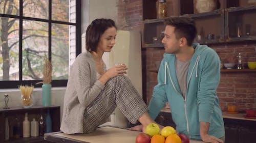 Friends in Apartment Talks in Kitchen