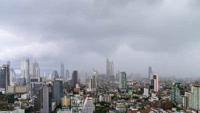 Bangkok business district city center during rain or rainstorm - Time Lapse
