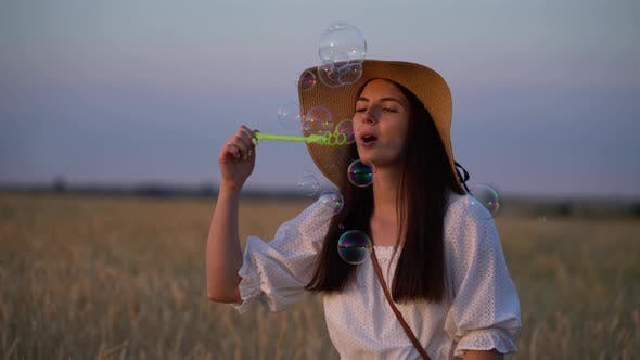 Thumbnail for Woman Blowing Soap Bubbles