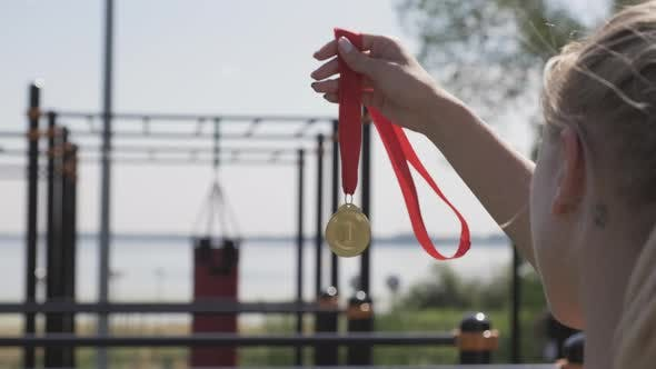 Sportswoman Holding Gold Medal