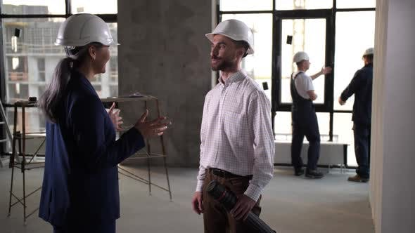 Interior Designers Shaking Hands After Joint Work