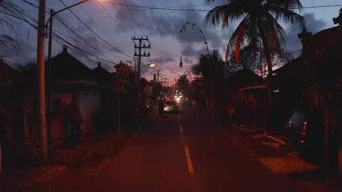 Street View of City Traffic in Tropical Bali Streets During Sunset