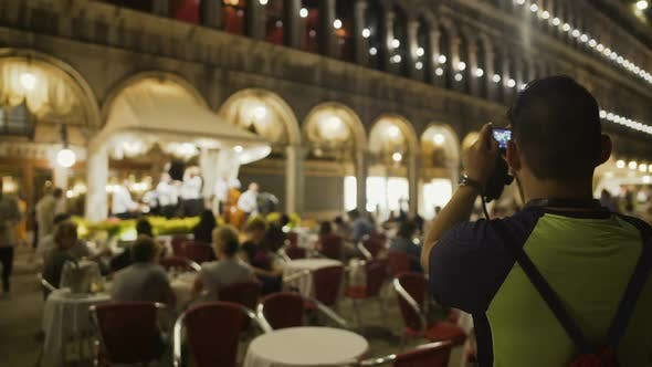 Thumbnail for Curious Male Tourist Filming Live Open Air Performance of Italian Music Band