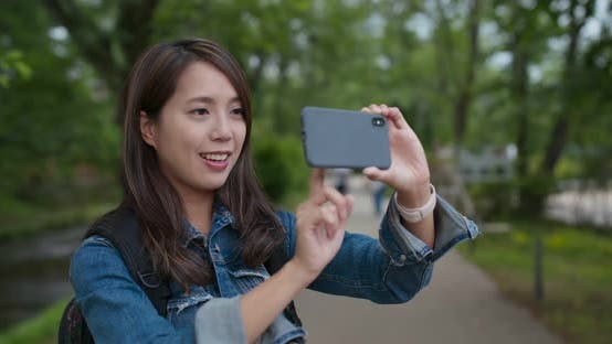 Thumbnail for Woman take photo on cellphone in the countryside