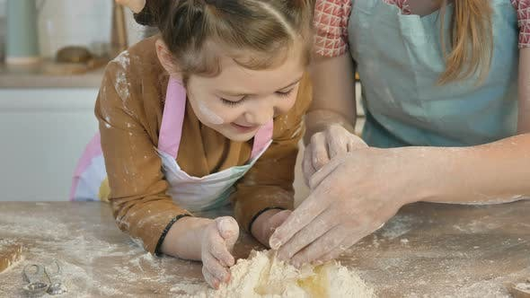 Thumbnail for Mother Helps Daughter Mix Egg with Flour To Make Pie Dough