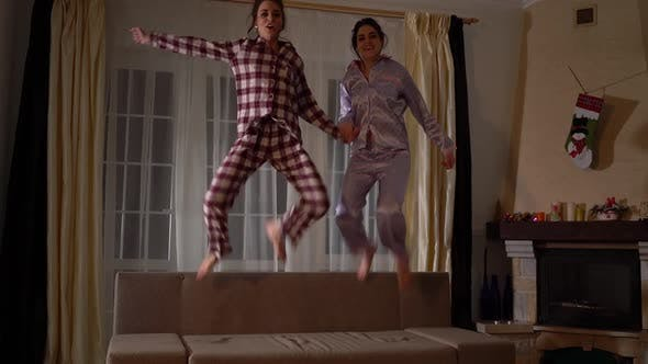 Thumbnail for Two Happy Sisters Twins in Pajamas