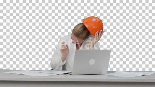 Tired young woman in safety helmet yawning, Alpha Channel