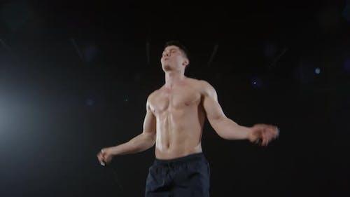 Topless Man Using Jump Rope