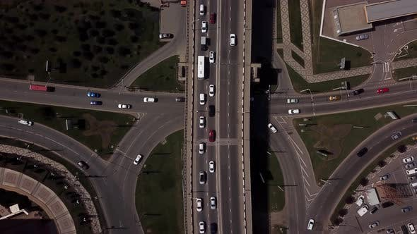 Thumbnail for Drone's Eye View -  Overhead Top Down View Of Traffic Driving Over A Modern Bridge