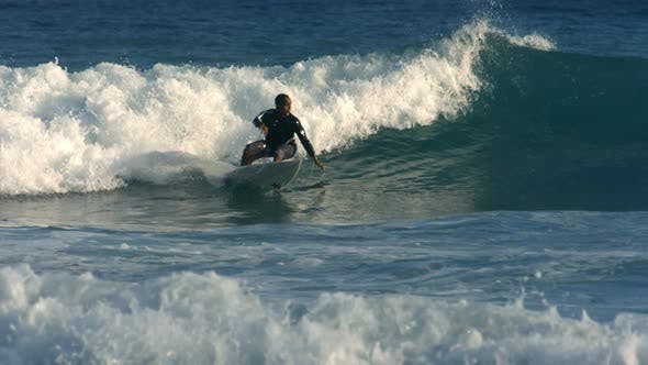 Thumbnail for Surfer rides wave, slow motion