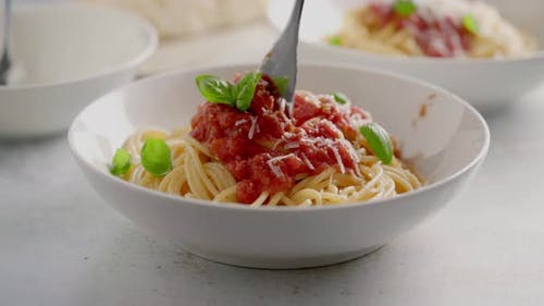 Spaghetti with Tomato Sauce and Basil on a Plate