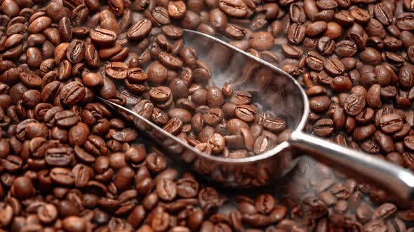 Thumbnail for Close Up of Seeds of Coffee. Fragrant Coffee Beans Are Roasted Smoke Comes From Coffee Beans.