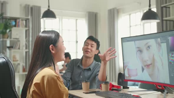 Happy Asian Male And Female Professional Editors Talking While Working In Photo Editing On Computer