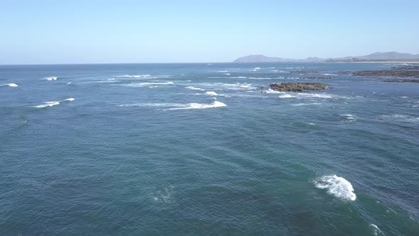 Thumbnail for Aerial of Pacific Ocean Blue Water and Rocks Unspoiled No People Waves