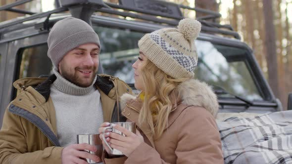 Thumbnail for Couple Drinking Hot Tea Outdoors