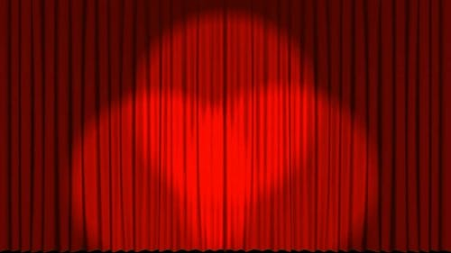 Theater stage curtains opening.