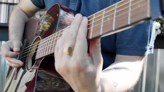 Thumbnail for Close Up Male Bassist Hands Playing on Guitar Touching Strings on Rock Performance Man Musician
