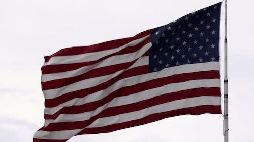 United States flag waving in the breeze.