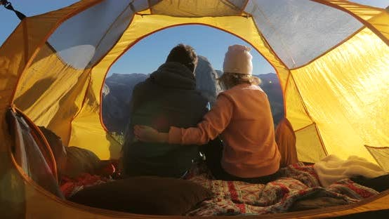 Thumbnail for Lovers Cuddle in a Tent at the Background of the Symbol of Yosemite National Park,the Half Dome Rock