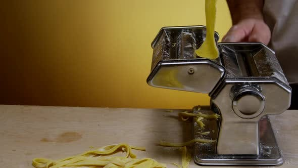 Thumbnail for Adult Man Hands Preparing Dough For Homemade Pasta 14