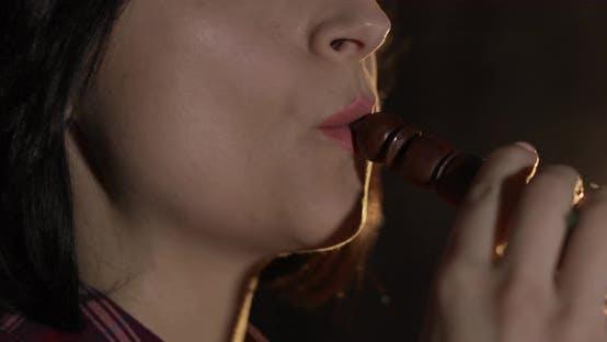 Thumbnail for Beautiful, Young Woman Smoking Hookah. Attractive Girl Smoking Flavored Tobacco