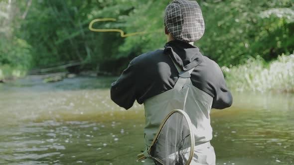 Thumbnail for Fisherman Fishing In River