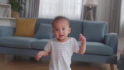 Baby Boy Learning To Walk At Home