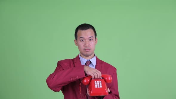 Thumbnail for Face of Sad Asian Businessman Using Telephone and Crying