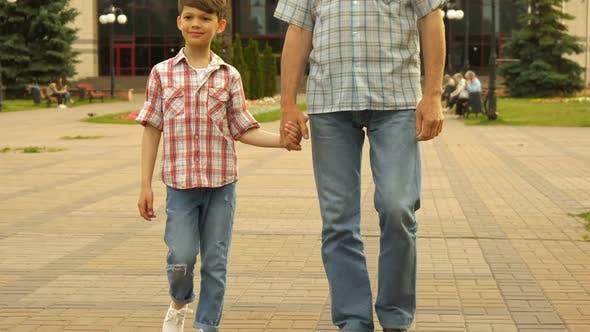 Thumbnail for Senior Man Walks with His Grandson Outdoors