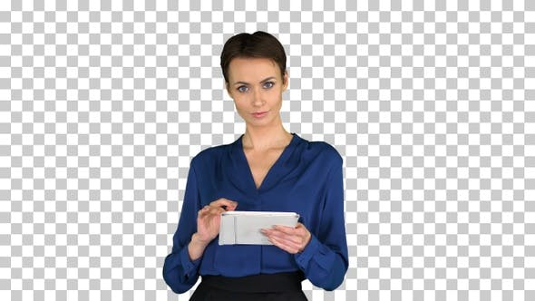 Businesswoman isolated swiping the tablet, Alpha Channel