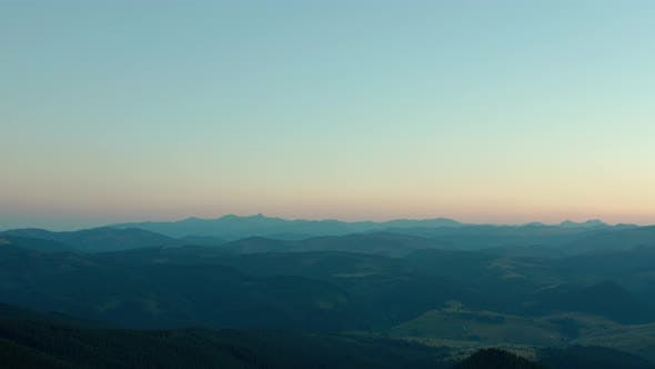 Thumbnail for Aerial Drone View a Beautiful Evening in the Mountains with the Moon. Wide Shot V2