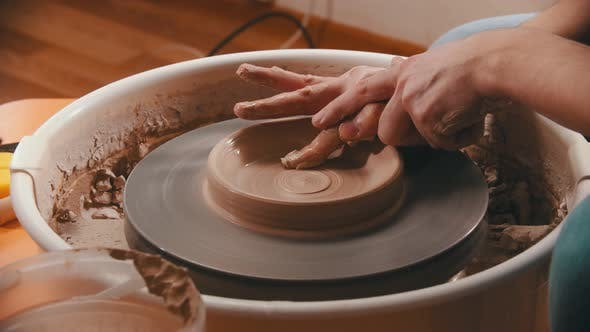 Thumbnail for Pottery -The Master Is Removing Clay From the Bottom of the Clay Bowl