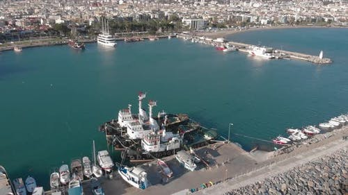 Docked recreational boats and yachts at marina in blue lagoon