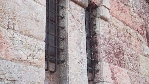 Lattice windows of ancient church with weathered wall
