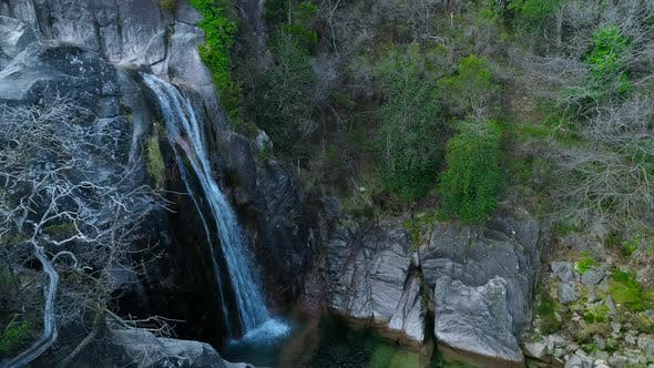 Thumbnail for Top Down View Over the Waterfall Running Down the Rocky Cliff