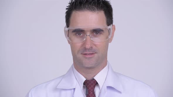 Thumbnail for Face of Happy Handsome Man Doctor Smiling and Wearing Protective Glasses
