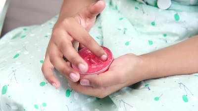 Child Girl Using Petroleum Jelly Onto Skin at Home Close Up