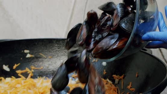 Thumbnail for Close Up Chef Pour the Mussels Into the Pan Toassing Mussel Pan. Slow Motion
