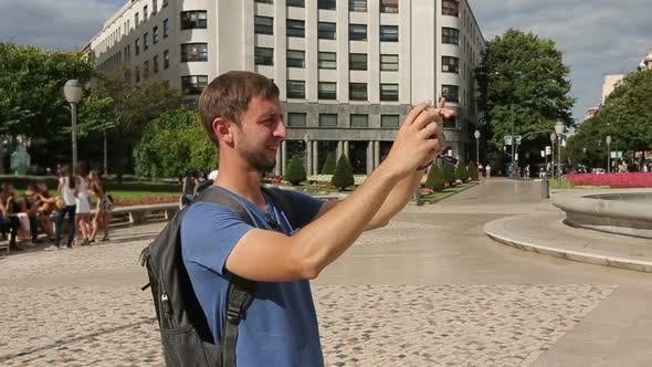Curious Tourist Taking Photos of Beautiful Bilbao City on Smartphone Camera