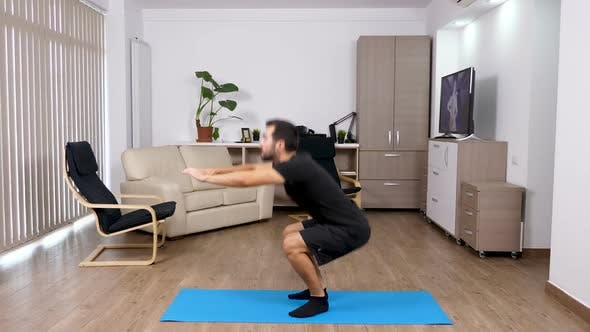 Thumbnail for Sport at Home - Athletic Man Doing Squats in the Living Room