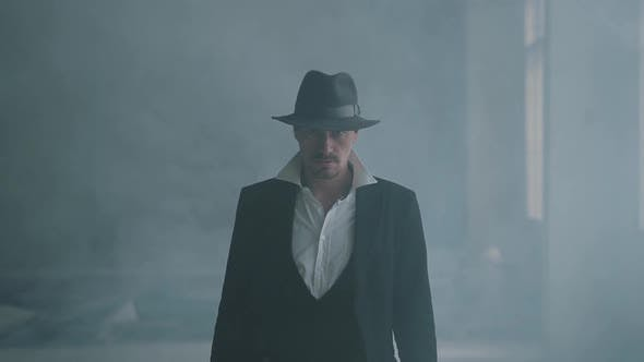 Thumbnail for Portrait Confident Brutal Gangster in Fedora Hat and Classical Suit Walk From Smoke. Slow Motion