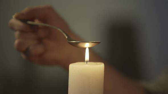 Thumbnail for Hand of Person Heating Chemical Substance in Spoon on Candle Light, Drug Abuse
