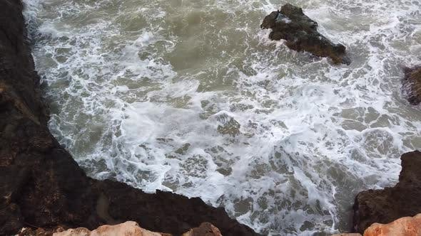 Thumbnail for Big Wave Hitting Into Rock Splashing High with Lots of White Foam at Beach in a Windy and Rainy Day