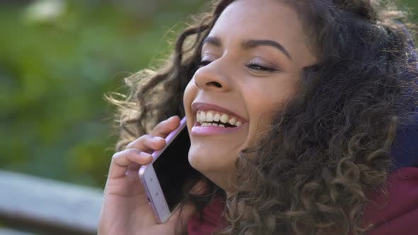 Cover Image for Young Attractive Female Talking With Her Friend Over Mobile Phone, Closeup