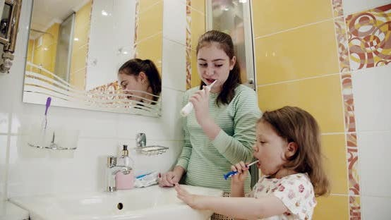 Thumbnail for Little Two Sisters Brushing Their Teeth Intensely in the Bathroom
