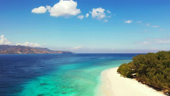 Thumbnail for Tropical flying copy space shot of a sandy white paradise beach and turquoise sea background in 4K