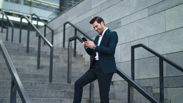 Thumbnail for Businessman Standing at Stairs Outside. Man Thinking in Stylish Suit Outdoor
