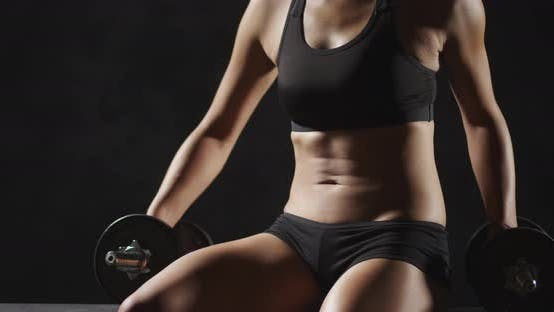 Thumbnail for Fitness woman holding dumbbells training working out
